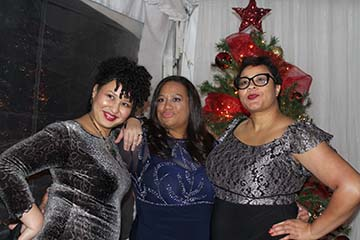Three Ladies in Front of Christmas Tree